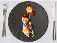 Seared scallops & Rodriquez spiced chorizo, cauliflower puree, squid ink meringue, coriander oil
